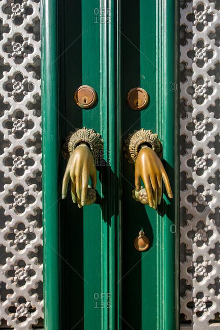 Algarve, Portugal - August 6, 2019: Door knockers in the form of hands