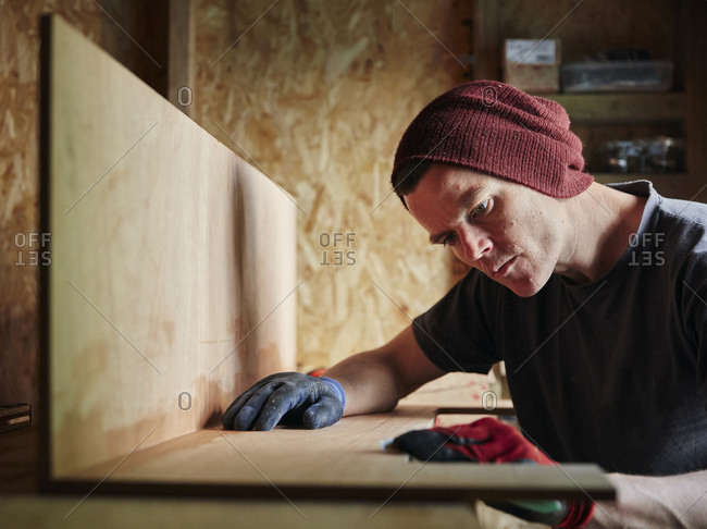 Focused male carpenter working in shed