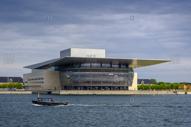 June 10, 2019: Denmark- Copenhagen- Motorboat passing in front of Copenhagen Opera House