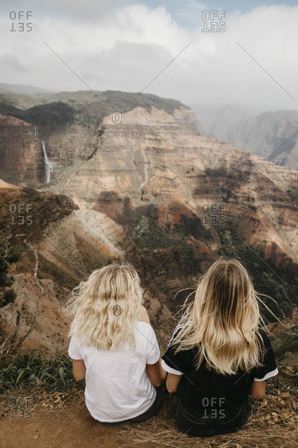 Rear view of female friends looking at dramatic landscape in Waimea Canyon- Kauai- Hawaii- USA
