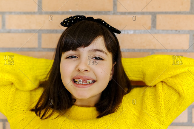 Portrait of a girl with braces on her teeth