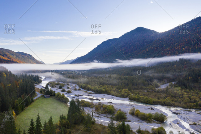 Germany- Bavaria- Fog floating over Isar river flowing through forested valley in Wetterstein Mountains