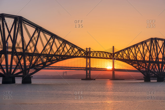 UK- Scotland- Silhouettes of Forth Bridge and Forth Road Bridgegate sunset