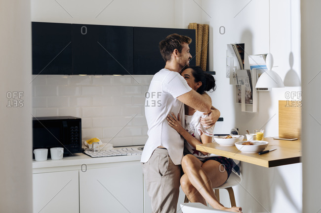 Affectionate young couple in the morning in kitchen