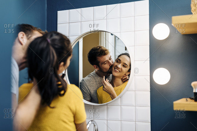 Affectionate young couple in bathroom at home