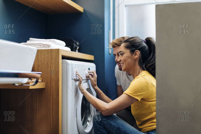 Young couple doing the laundry at home