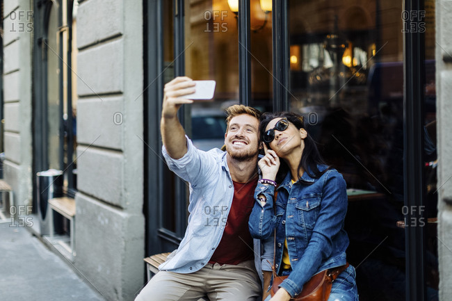 Happy young couple taking a selfie in the city- Milan- Italy