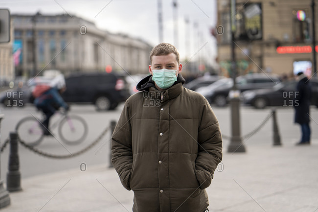 Young man with face mask- commuting in the city- St. Petersburg- Russia