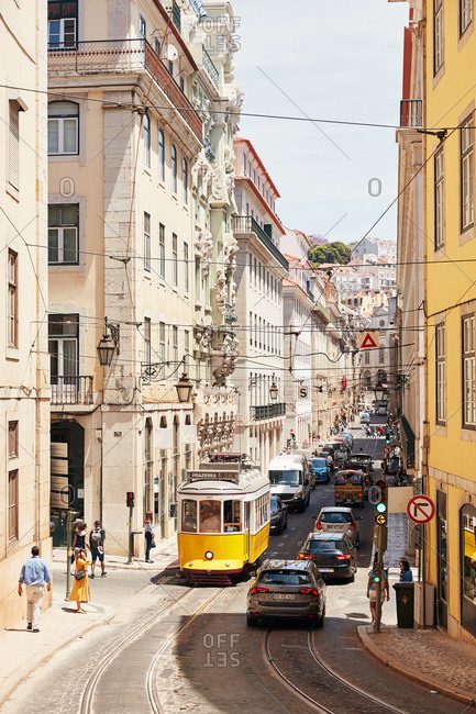 Lisbon, Portugal - May 24, 2019: Traditional tram car on the Lisbon tramway on a busy street