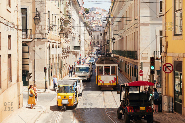Lisbon, Portugal - May 24, 2019: Tram car on the Lisbon tramway on a busy street