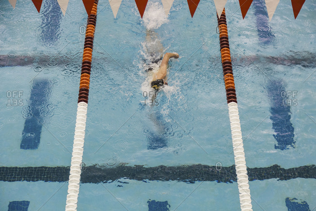Overhead view of competitive swimmer racing in a pool