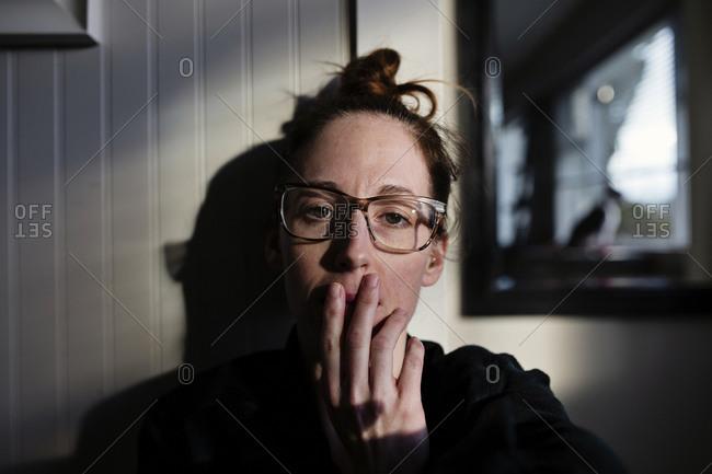 Woman taking self portrait of herself wearing glasses