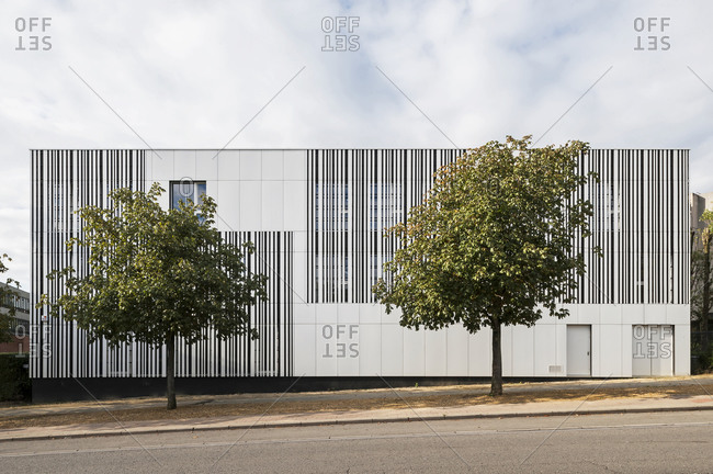 Black and white striped modern school exterior in Brussels, Belgium