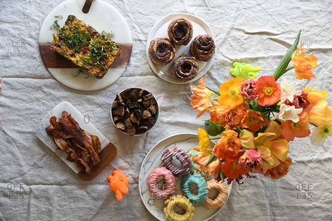 Overhead view of breakfast foods and flowers for Easter brunch