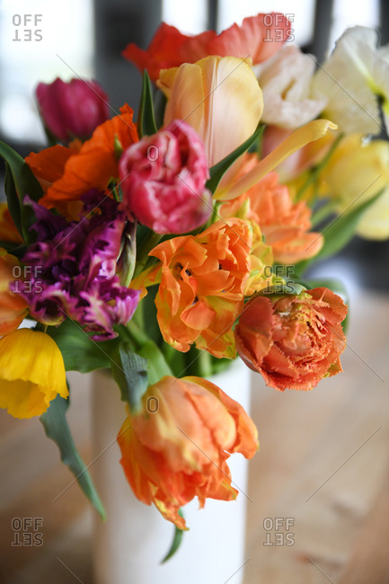 Close up of colorful flowers in a white vase