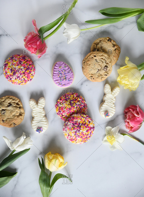 Cookies and tulips on white marble surface for Easter