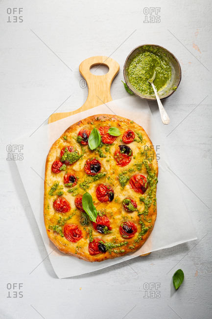 Focaccia with tomatoes and pesto