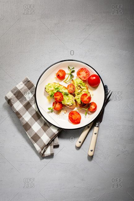 Smashed avocado and tomatoes on toast