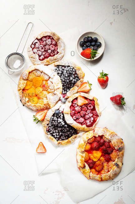 Different sizes of rustic fruits tarts