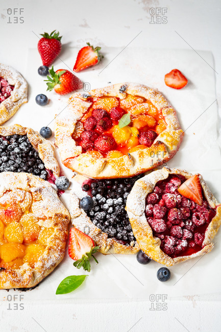 Close up of summer rustic fruits and berries galettes