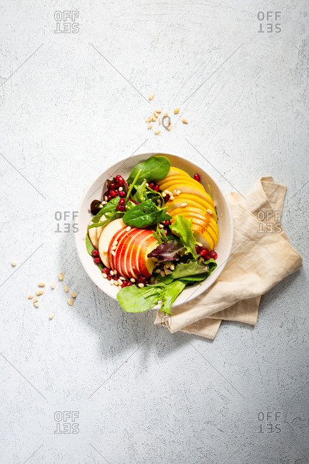 Healthy detox fruits salad in bowl on light surface