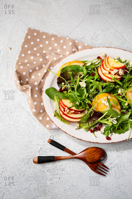 Apple and pear salad with cheese on vintage plate