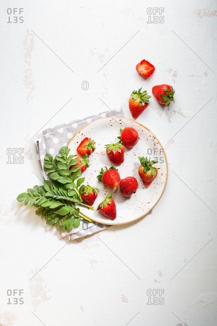 Strawberry on plate and polka dots cloth