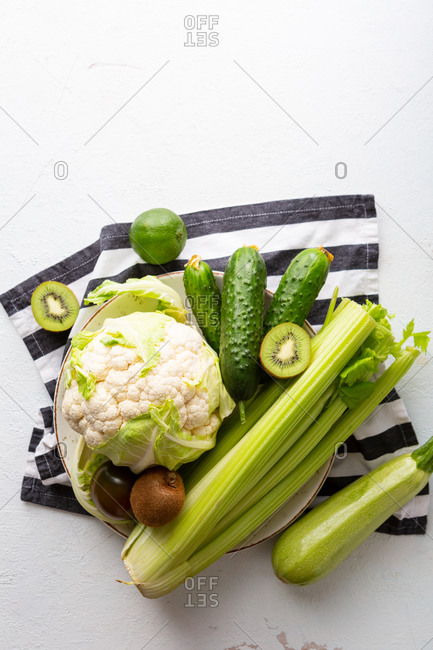 Fresh green vegetables on linen cloth