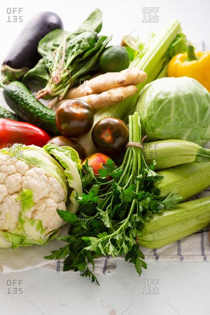 Fresh farm vegetables on white surface