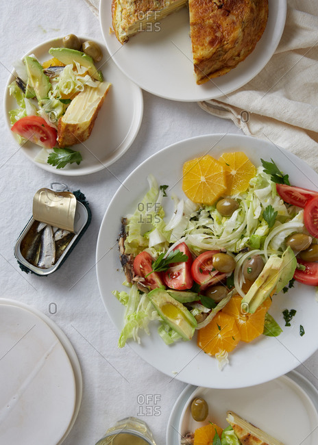 Overhead view of salad, Spanish omelet and sardines