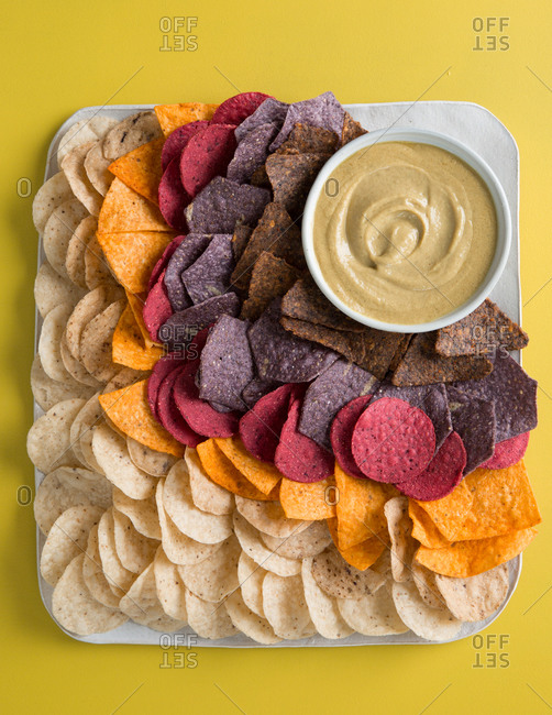 Variety of vegetable based corn chips and vegan queso dip