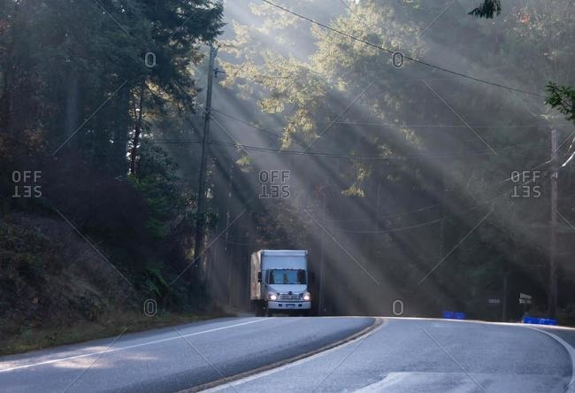 Truck driving along a mountain road, British Columbia, Canada