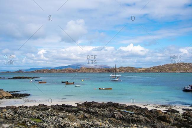 Small Boats Anchored at sea, Iona, Inner Hebrides, Scotland, UK