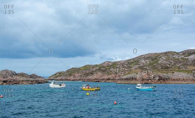 Three fishing Boats anchored at sea of Isle of Mull, Inner Hebrides, Scotland, UK