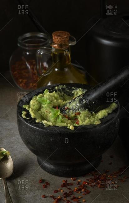 Freshly prepared guacamole in a pestle and mortar