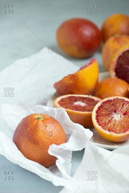 Close-up of sliced blood oranges on a table