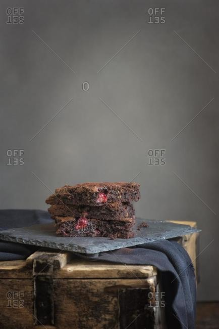 Slices of chocolate strawberry cake on slate