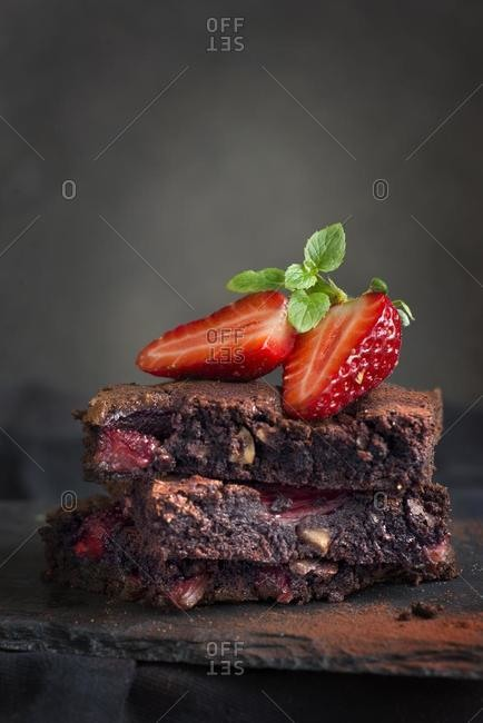 Slices of strawberry cake topped with a strawberry