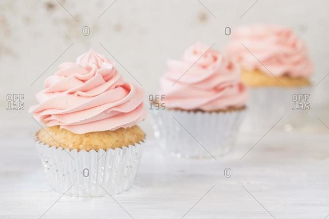 Three cupcakes with buttercream icing