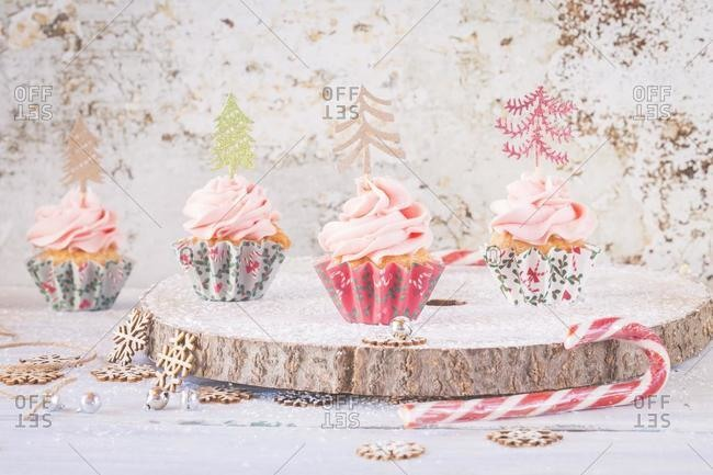 Cupcakes with buttercream icing decorated with Christmas trees
