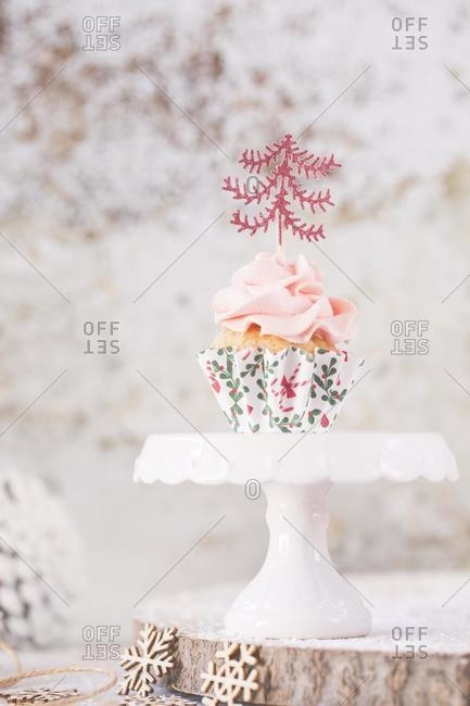 Cupcake with buttercream icing decorated with Christmas trees