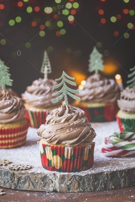 Cupcakes with chocolate buttercream icing decorated with Christmas trees