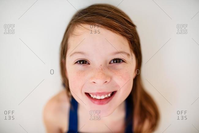 Portrait of a smiling girl with freckles