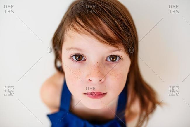Portrait of a serious girl with freckles