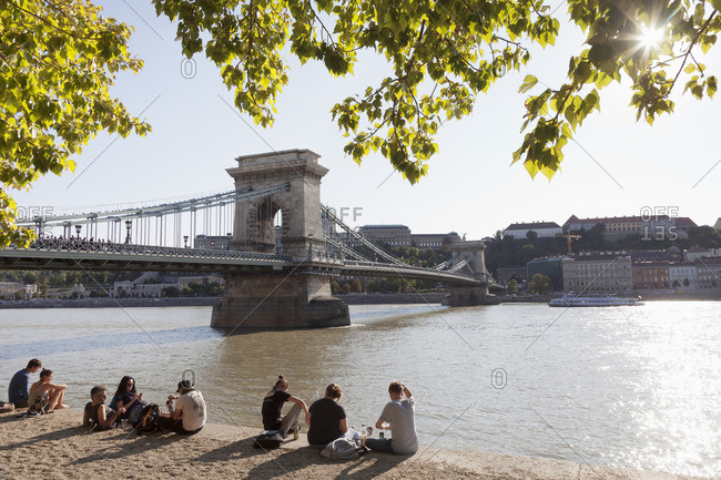 August 22, 2017: Tourists on the bank of Danube with a view to the Chain Bridge, Budapest, Hungary