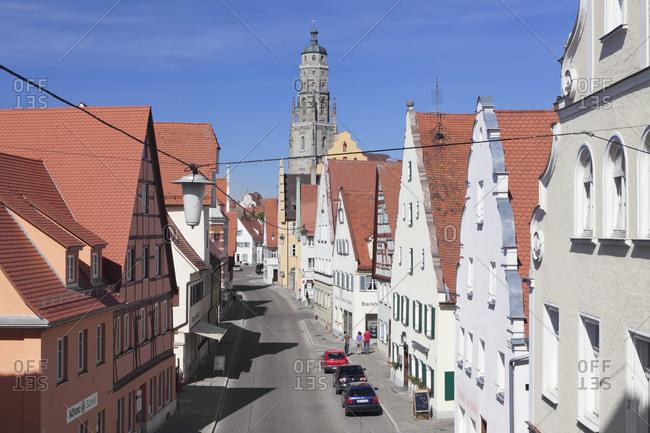 May 30, 2011: Reimlinger Strasse and parish church Sankt Georg (Daniel), Nordlinger, Romantic Road, Swabia, Bavaria, Germany
