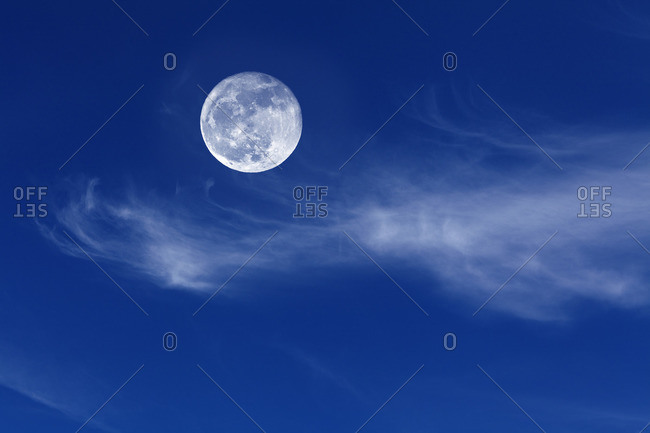 Feather clouds with full moon