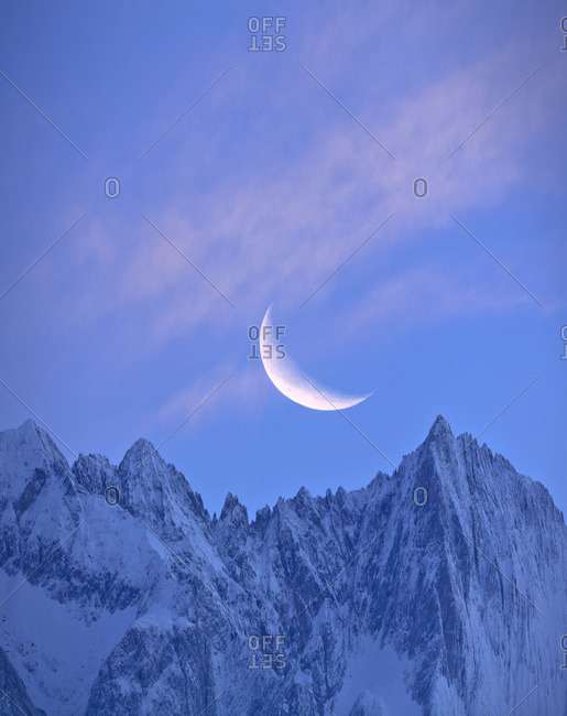 Mountain landscape with crescent moon