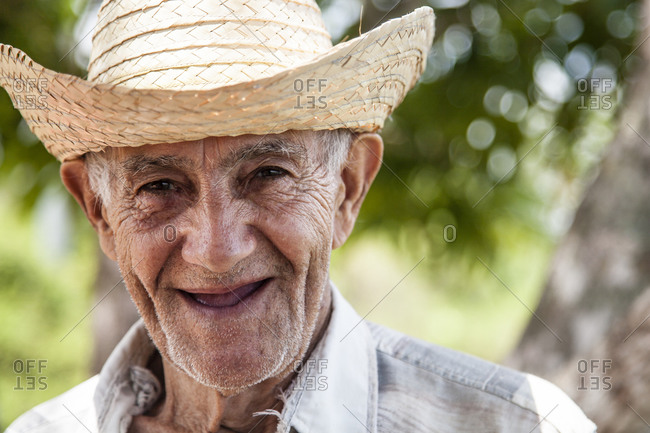 old man with straw hat smiles at the camera, portrait, Trinidad, Vinales, Cuba