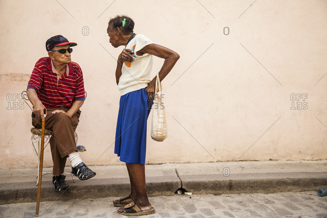 April 18, 2012: Street scene in Vinales, Cuba, old man and woman in conversation